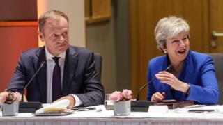 "European Council President Donald Tusk (L) and Britain""s Prime Minister Theresa May look on during a European Council meeting on Brexit"