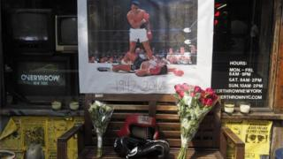 A memorial for boxing legend Muhammad Ali is seen outside the Overthrow Boxing Club in New York, US, 4 June 2016