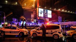 Police secure the area after a gun attack on Reina, a popular night club in Istanbul