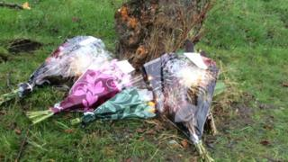 Flower tributes at scene of crash