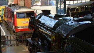 Virgin Trains power car and Flying Scotsman at National Railways Museum, in York.