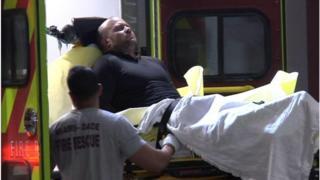 Gunman on a stretcher