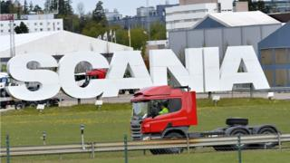 Scania truck outside giant logo