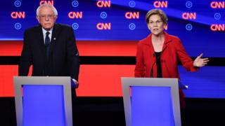 Bernie Sanders and Elizabeth Warren pictured at a debate