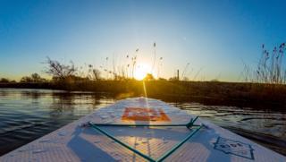 Stand-up paddle boarding at sunrise near Northmoor Lock