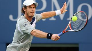 "Andy Murray of the United Kingdom hits a backhand to Roger Federer of Switzerland in the 2008 U.S. Open Men""s Championship"