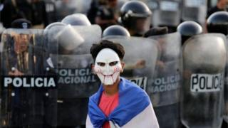 A masked youngster protests against Nicaraguan President Daniel Ortega in Managua on 13 September, 2018.