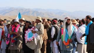 Marchers with a mountainous scenic backdrop in Wardak district, Afghanistan on 14 June 2018