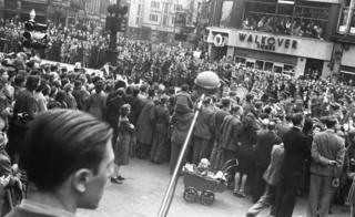 A microphone picks up sound of the crowd at the Victory Parade