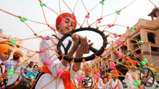 A Sikh boy performs Gatkha - a traditional form of martial arts during a religious procession