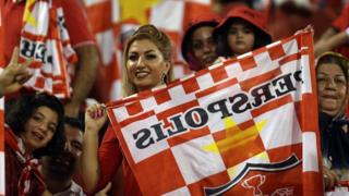 Iranian female fans cheer on Persepolis FC at the Sultan Qaboos Sports Complex in Muscat, Oman, on 22 August 2017