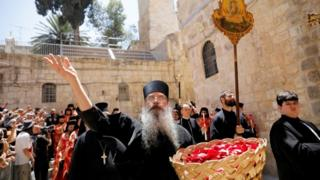 A member of the Greek Orthodox clergy at the Church of the Holy Sepulchre in Jerusalem's Old City