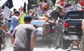 Car ploughs into protesters at Charlottesville protest