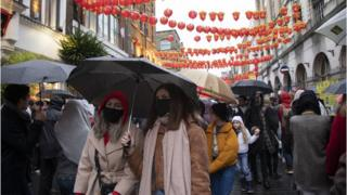People wearing face masks in London's China town