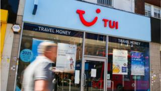 positive people man walks past Tui shop