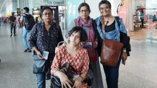 Disability activists Kuhu Das (standing left) and Jeeja Ghosh (seated) at Kolkata airport
