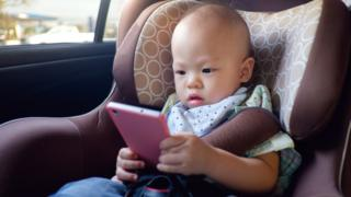 infant using a screen