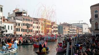 in_pictures Venetians row during the masquerade parade on the Grand Canal during the Carnival in Venice