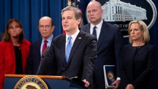 FBI Director Christopher Wray speaks at a news conference