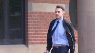 Daniel Garland entering court
