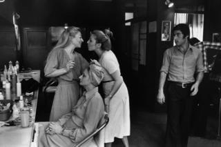 Two women greet each other inside a hair salon in Tehran in 1976