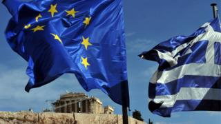 Greek and EU flags in Athens