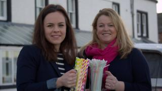 Kate Forbes holding straws