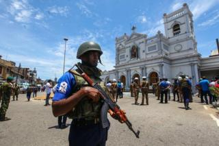 Sri Lankan security forces secure the area around St. Anthony's Shrine after an explosion hit St Anthony's Church in Kochchikade