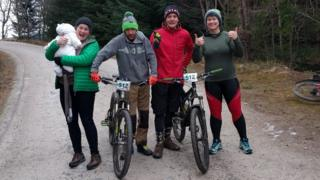 Barbara Murray with Lucy and team-mates on the Strathpuffer course