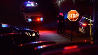 Police investigate the scene after a shooting in Wilkinsburg