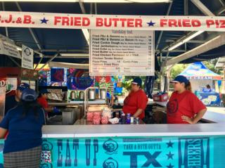 A stand full of deep-fried food on the menu