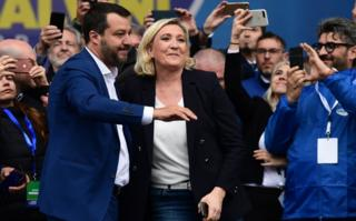 Italian Deputy Prime Minister and Interior Minister Matteo Salvini (L) and President of the French far-right Rassemblement National (RN) party Marine Le Pen react on stage at a rally of European nationalists ahead of European elections on May 18, 2019