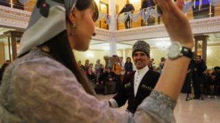 A man and woman dancing at a wedding in the Chechen capital Grozny