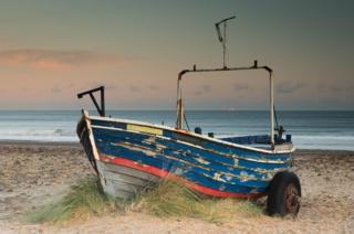 A boat frames a boat a sea