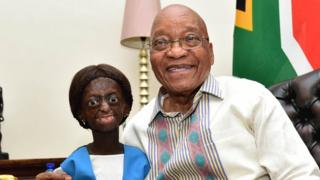 Ontlametse Phalatse standing and smiling next to Jacob Zuma