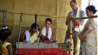 The Royal couple watch an Indian woman make hand woven cloth