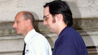 Jeffrey Gafoor led into Cardiff Crown Court for sentencing in July 2003