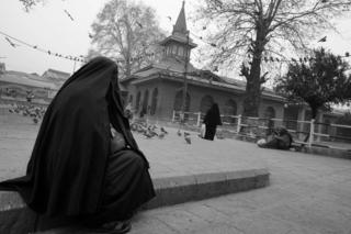 A women at a shrine in Srinagar