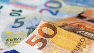 Euro banknotes and coins background