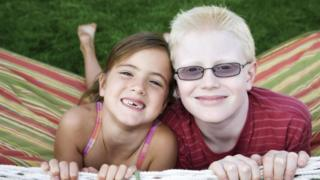 A boy with albinism with his sister