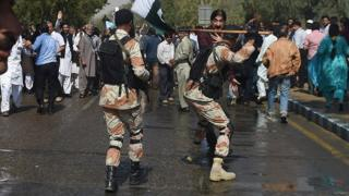 Pakistani paramilitary soldiers and protesters clash in Karachi