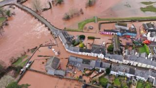 Roads and gardens in Crickhowell, Powys, were turned into lakes, after the river burst its banks