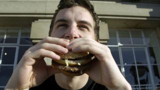 a man eats a burger