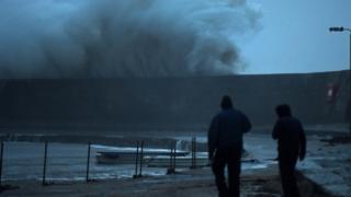 A huge wave breaks on the Cobb in Lyme Regis