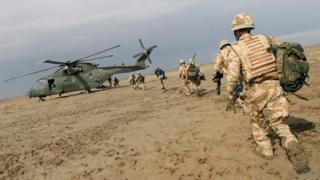 UK troops and a military helicopter