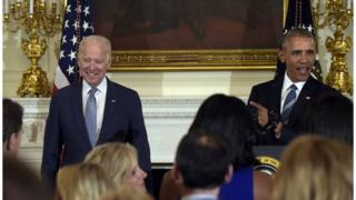 President Barack Obama honours Vice President Joe Biden during a ceremony in the State Dining Room of the White House in Washington