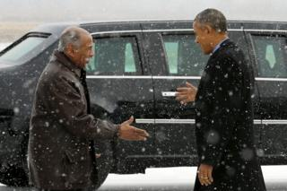 environment John Conyers (D-MI) (L) greets President Barack Obama as he arrives aboard Air Force One at Detroit Metropolitan Wayne County Airport in Detroit, Michigan January 20, 2016.