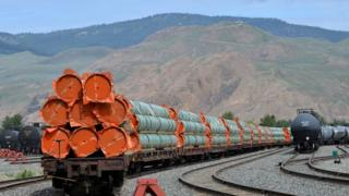 "Steel pipe to be used in the oil pipeline construction of Kinder Morgan Canada""s Trans Mountain Expansion Project sit on rail cars at a stockpile site in Kamloops, British Columbia,"