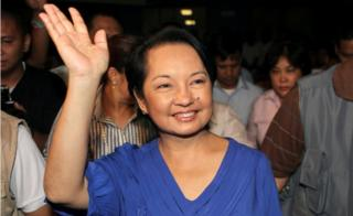 Gloria Macapagal Arroyo waves to supporters after winning a congressional seat on 12 May 2010, as she was leaving the post of president.