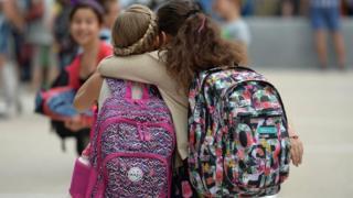 children with rucksacks